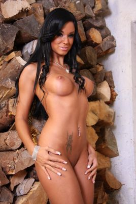 The pornstar Ashley Bulgari is prepairing the wood for the winter.